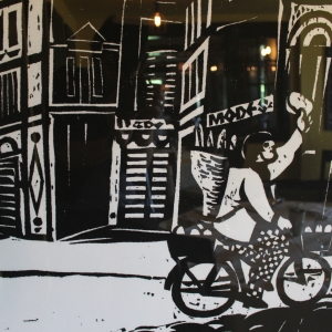 black and white art of man riding on bike with bread